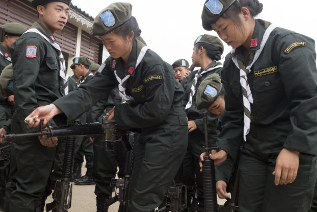 Soldiers check their guns before taking part in Shan State National Day.